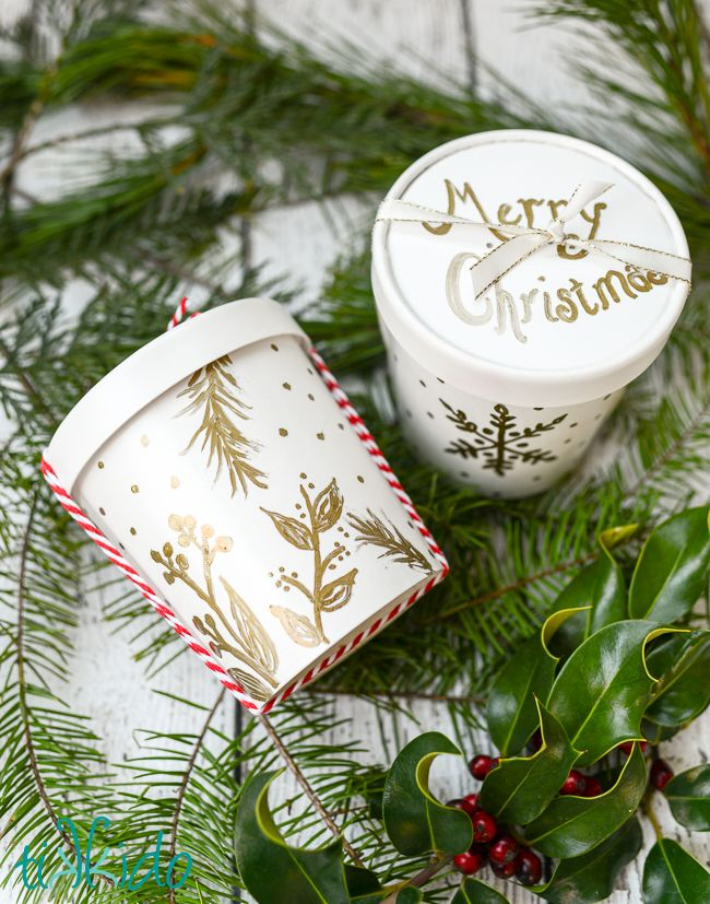 Easy, elegant, food-safe packaging for your Christmas Cookies. I was inspired by the gold foil designs on our Shutterfly Christmas cards, and duplicated them with a gold paint pen on a take-outcontainer. #ad