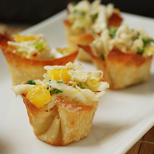 Mango Crab Salad served in Wonton Cups        http://www.multiplydelicious.com/thefood/2011/05/mango-crab-salad-in-wonton-cups/