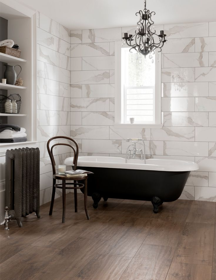 Designed To Replicate The Stunning White Calacatta Marble Found In Italy This Ceramic Wall T Wood Tile Bathroom Modern Bathroom Tile Traditional Bathroom Tile