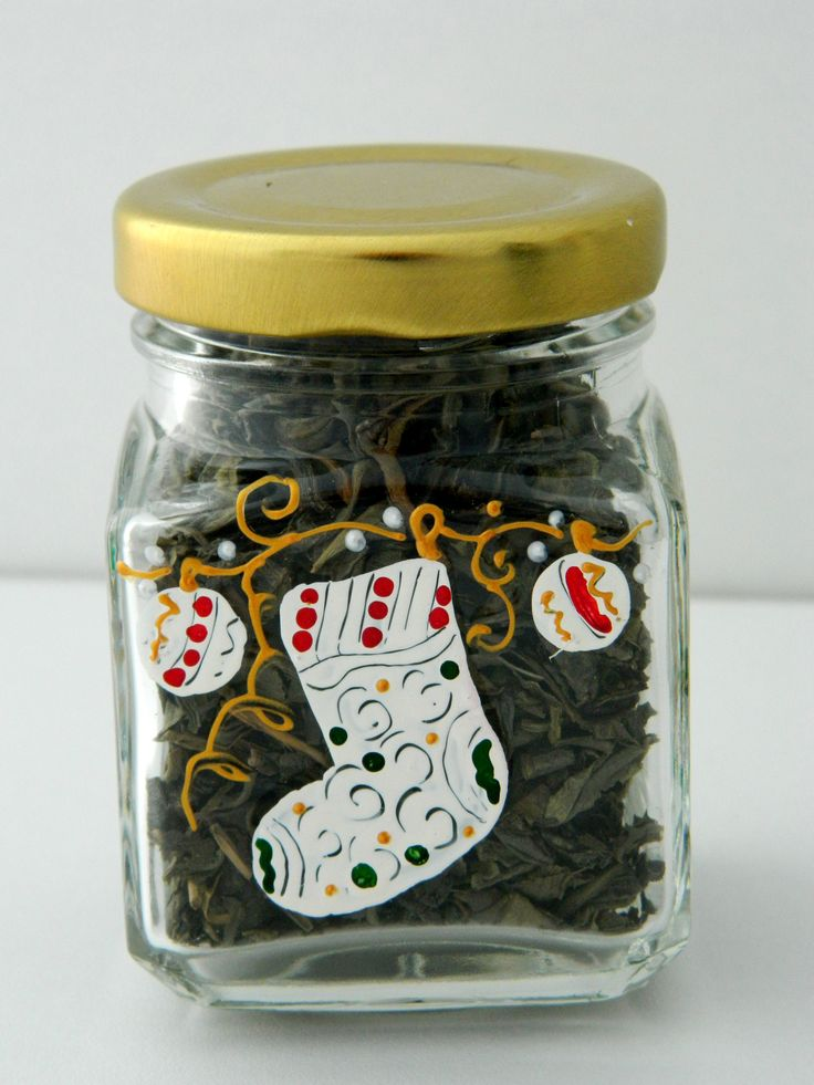 Hand painted tea jar with Christmas sock and decorations.