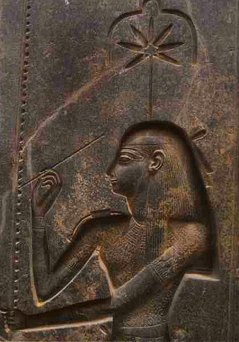 """Goddess Seshat – personification of writing.This relief in the Amun temple at Luxor dates from around 1250 BCE and shows Seshat, the goddess of temple geometry and scribal arts, inscribing regnal years for the king on the palm-leaf rib which had long served for tallying up the years and so had become the hieroglyph for """"year""""."""