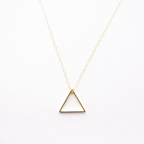 A gold plated brass triangle hung on a 14k gold chain with gold spring ring clasp. Simple and stylish, this minimal geometric necklace is perfect for any occasion. #jewellery #necklace #triangle