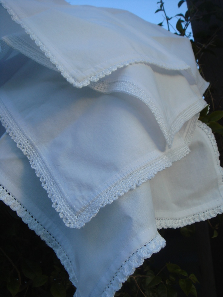 Napkins with crocheted edges.