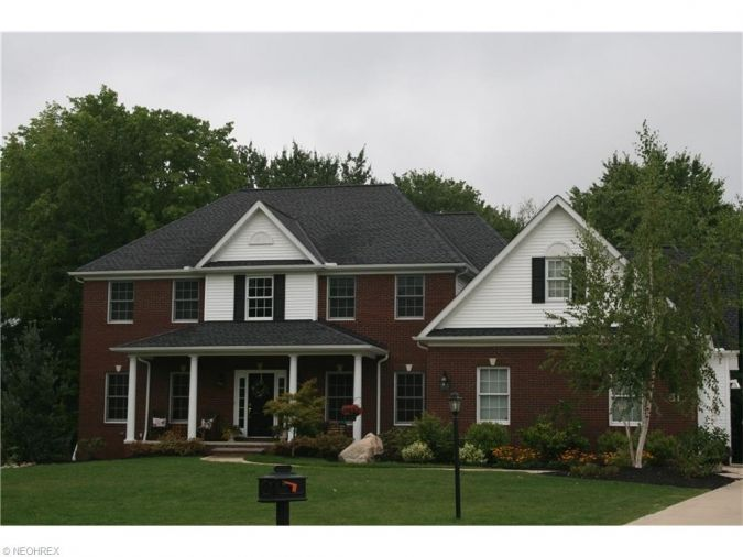 Brecksville colonial on 1.79 acre cul-de-sac lot. Four bedroom home with 4 full baths and 1 half bath. Breathtaking foyer with