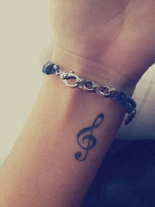 small music symbol tattoo