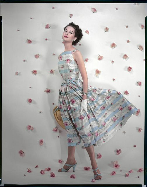 I utterly adore the pink rose print of her beautiful summer dress. #vintage #fashion #1950s