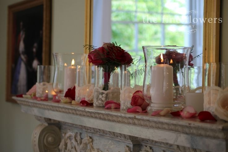 mantlepiece flowers and candles along fireplace mantlepiece from Pembroke Lodge wedding