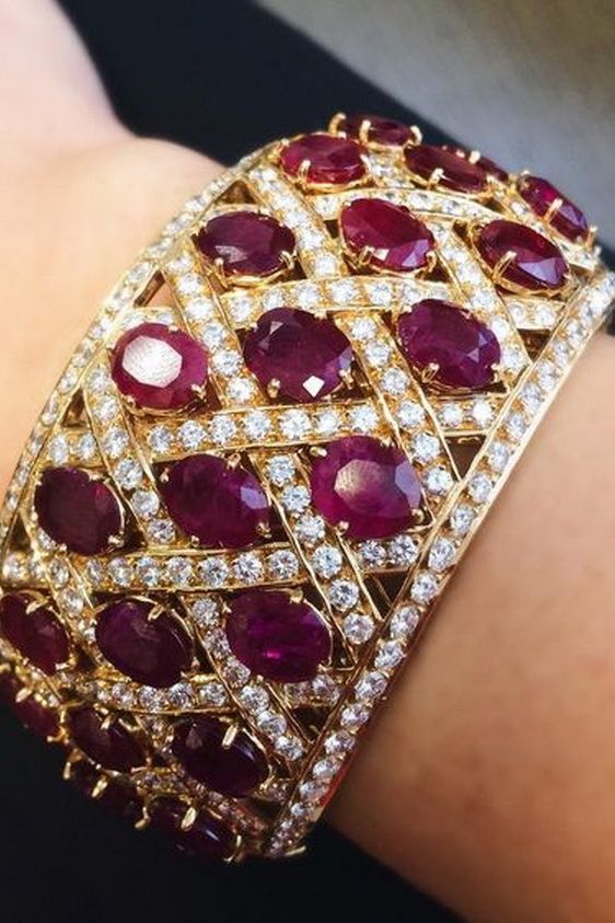 My version of a love bangle on Valentine's Day: a ruby and diamond bangle by…