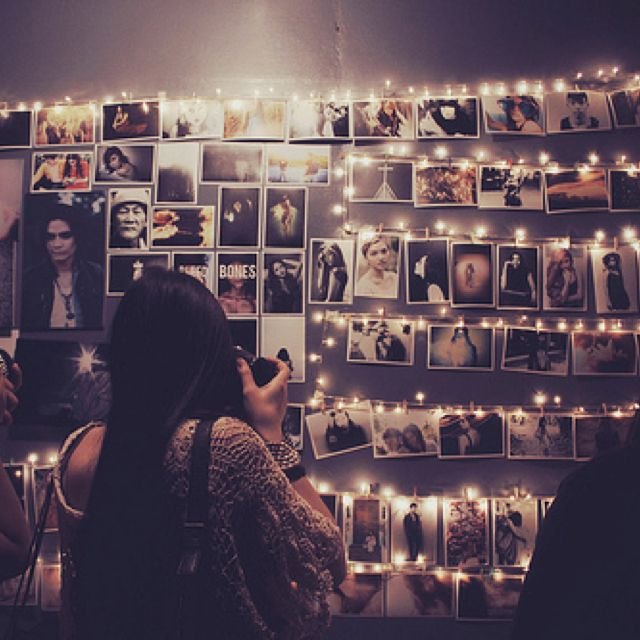 Photo wall. like the idea of combining fairy lights with the pics.