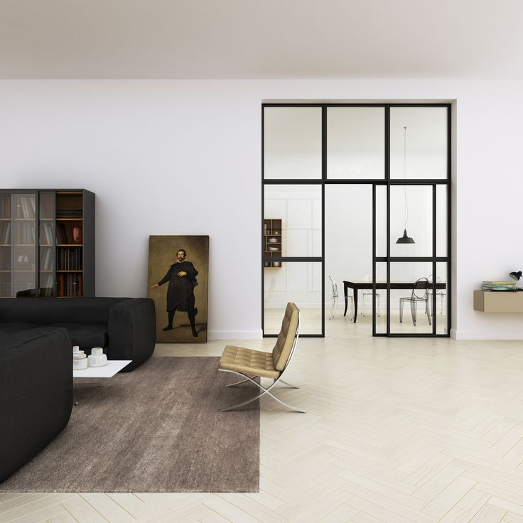 Living room view. Private apartment in Florence, Italy by Linee Studio. Barcelona armchair by Knoll, Victoria Ghost chairs by Kartell, Big Bubble sofas and Nadi table by Epònimo. Light oak parquet and large metal framed door in minimalist clean-cut environment.