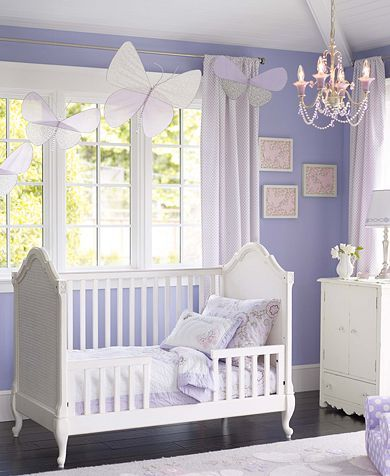 What a pretty butterfly bedroom for little girls. I love the combination of white and purple. The hanging butterflies and the chandelier are nice decorative touches.