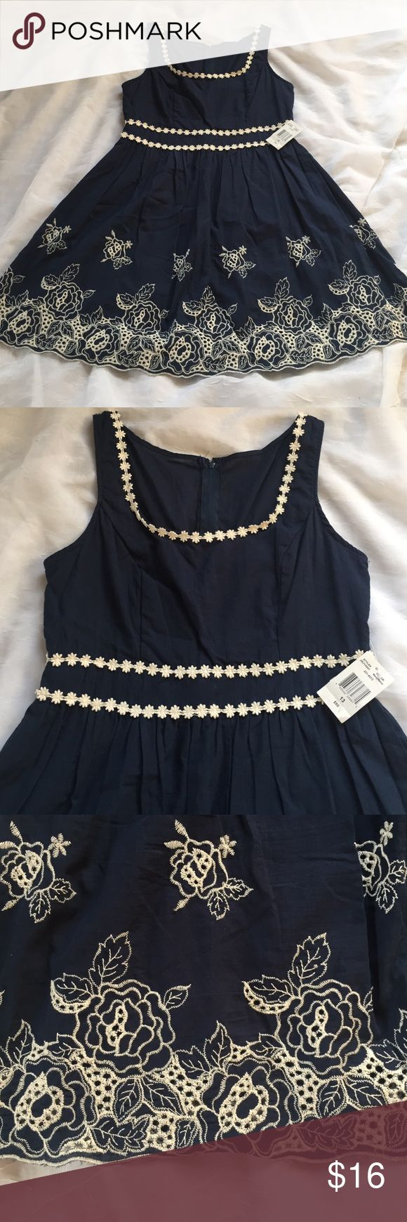 """NWT B Smart embroidered and eyelet dress, 13 Navy blue fit and flare dress with embroidered flowers along neck and at waist. Eyelet embroidered flowers along scalloped hem. 100% cotton shell with 100% polyester liner. Brand new with tags. Size 13 bust 36"""", waist 31"""", length 35"""". 💥Please use measurements provided and ask any question prior to purchase! I want happy customers. 😊 B. Smart Dresses Mini"""