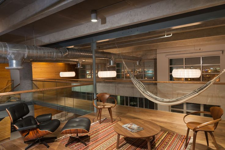Eames lounge chair and hammock in office of Miami loft renovation.
