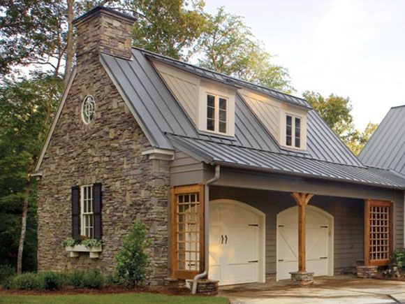 Stone garage with metal roof dormers for Garage roof styles