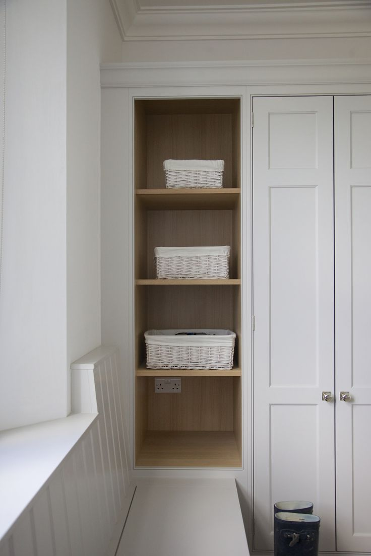 Project: Ashurst House | Kitchen Design: Nickleby | The Nickleby design embodies the true spirit of the classic contemporary kitchen. | This is the boot room which leads into the kitchen. #humphreymunson #bootroom #storage