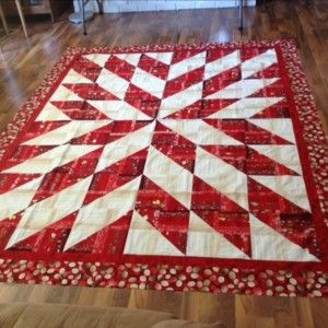 This started as the Rockin Rail Fence quilt but I didn't quite like the layout.  I made another row of blocks and found this design somewhere on the internet.  I'm not sure what the name is.  I call it the Starburst.  Please let me know if you have a name or pattern!   It's gone to the long armer's now.  Will update pics when it comes back!