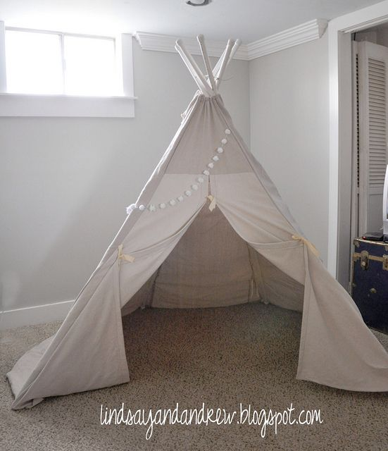 DIY teepee. Would be fab for an outdoor lawn party made lots bigger & filled with a rug and floor cushions