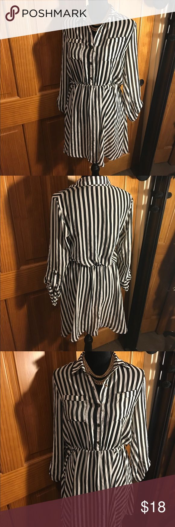 Dress from Windsor Black and white stripped dress from Windsor, size M. Missing the belt but any belt or no belt will look just as good. The dress is kind of see though, you would need to wear something black under. Material is thin. You can wear to work or a function. Dresses Mini