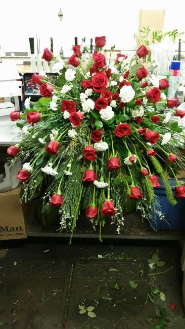 Red Roses and White Carnation Casket Spray with mixed Greenery