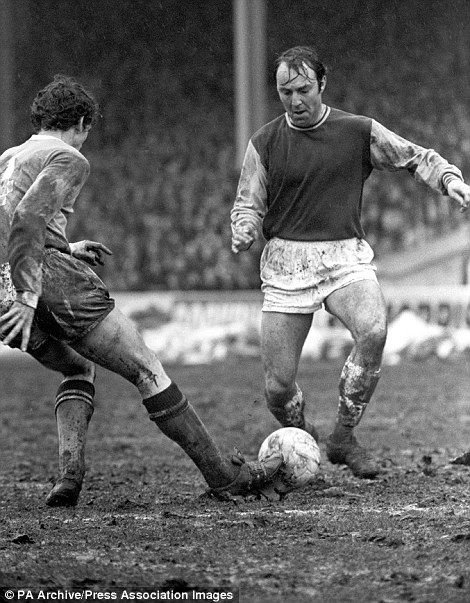 Jimmy Greaves, making his debut for West Ham United in their 5-1 win in 1970, is tackled by Manchester City's Mike Doyle