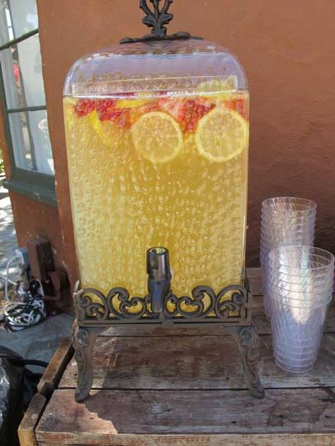 Recipe for White Wine Sangria for a Crowd - Ever need to make a large batch of booze for big group and don't want to spend $200 on fancy wine and fresh fruit? Today is your lucky day my friends.