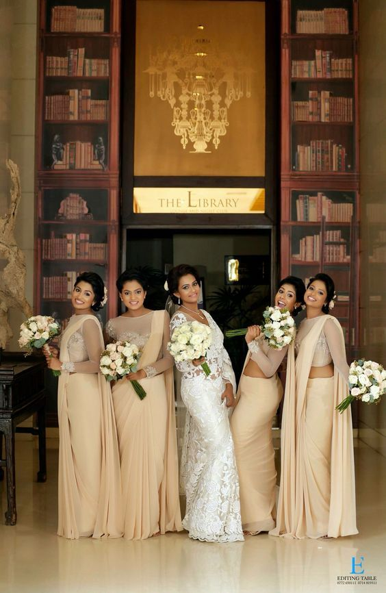 One with the bridesmaids! Lovely pick of the matching sarees to compliment the bride's own white elegant pick | Photo source : The Editing Table | #IndianWedding #bridalgown #christianwedding | Curated by #WittyVows - The ultimate guide for the Indian Bride | www.wittyvows.com