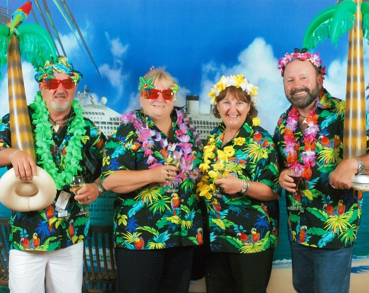 Island night with great cruise friends. LtoR Ray, Sandra, Jen and me. Our palm tree goes on every cruise :-)