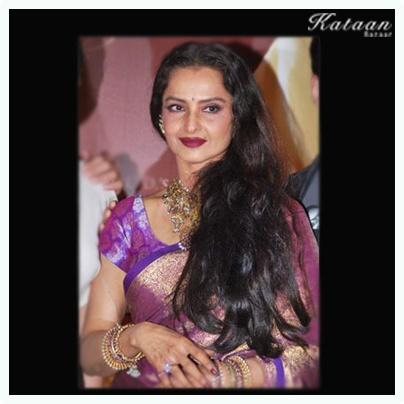 The evergreen Rekha in a stunning purple silk saree