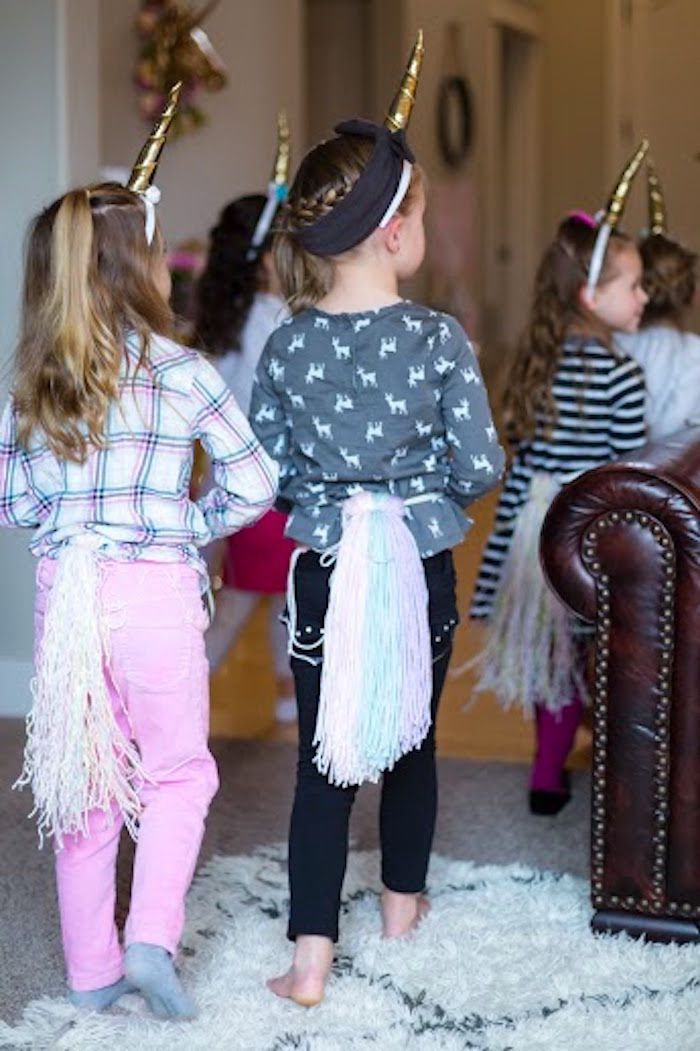 Girls in Unicorn Attire from a Rainbows & Unicorns Birthday Party via Kara's Party Ideas