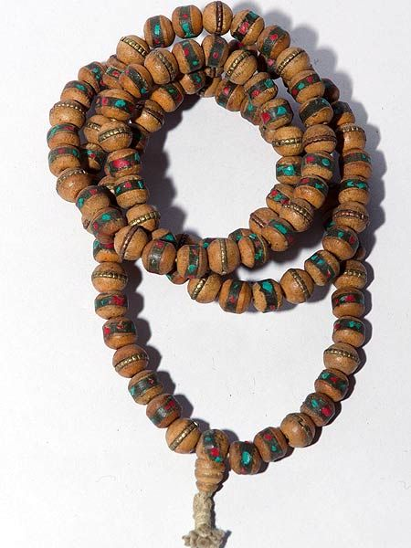 Mala with Tibetan inlay made from wood. 108 beads which are 9mm