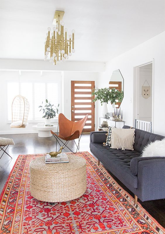 Modern Bohemian Inspired Living Room With A Large Rug, Gray Sofa, And A  Chandelier