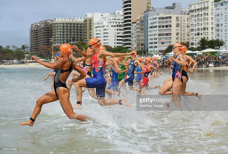 Andrea Hewitt of New Zealand, Flora Duffy of Bermuda and Katie Zaferes of the United States compete during the Women's Triathlon on Day 15 of the Rio 2016 Olympic Games at Fort Copacabana on August 20, 2016 in Rio de Janeiro, Brazil.