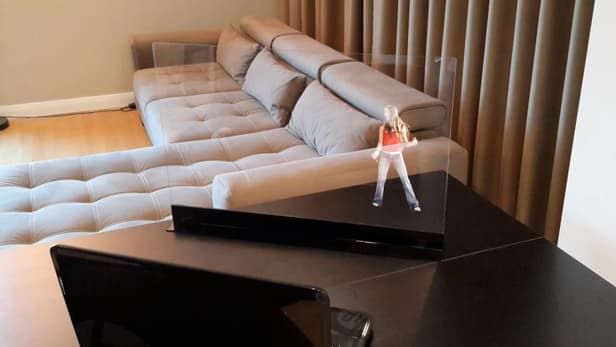 "Transparent screen displays free-floating ""holograms"" in your home - The system is designed to work with devices without the requirement of a projector or special equipment. In a sense, a smartphone, tablet, laptop or TV becomes the projector as it faces a HoloVit screen. One caveat is that it only works with content formatted as a hologram and it can be done with HoloVit, so users can record their own content and not have to access the thousands of images available - Image : Holovit"