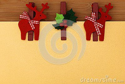 Christmas reindeer pegs decoration on gold background