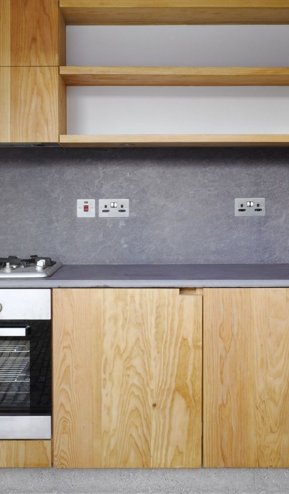 Kitchen | Concrete Wall | Open Shelving | Light Wood Cabinets | White, Grey | Natural Design