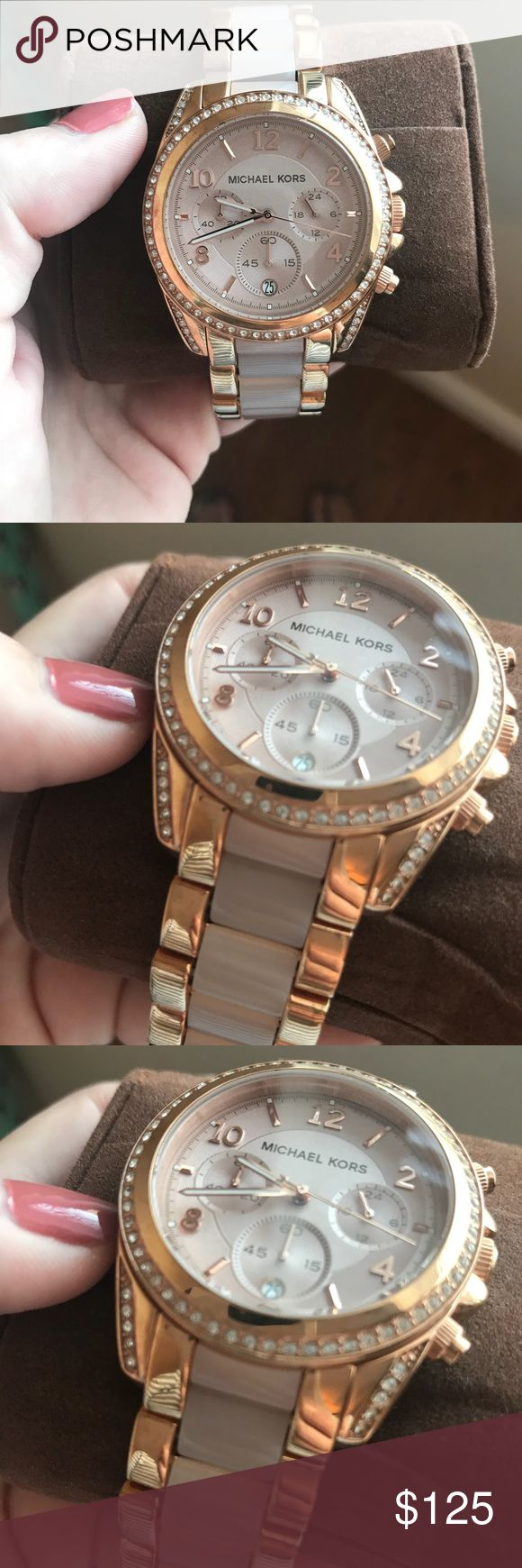 Like New Michael Kors rose gold watch Received as a gift and only worn once - didn't even have it sized so all links are in it. Looks amazing super pretty rose gold and pink Michael Kors watch. Box and the cushion are included. Does need a new watch battery. Michael Kors Accessories Watches
