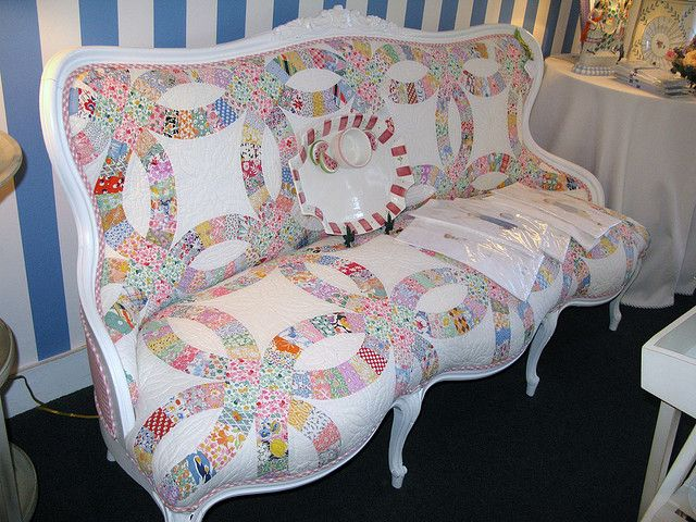 Fun idea to use a quilt for recovering an old chair.