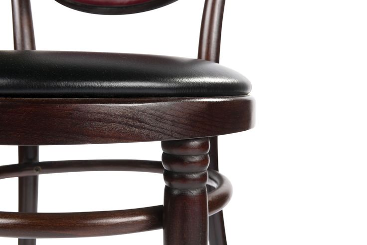 The chair with profiled tapering legs