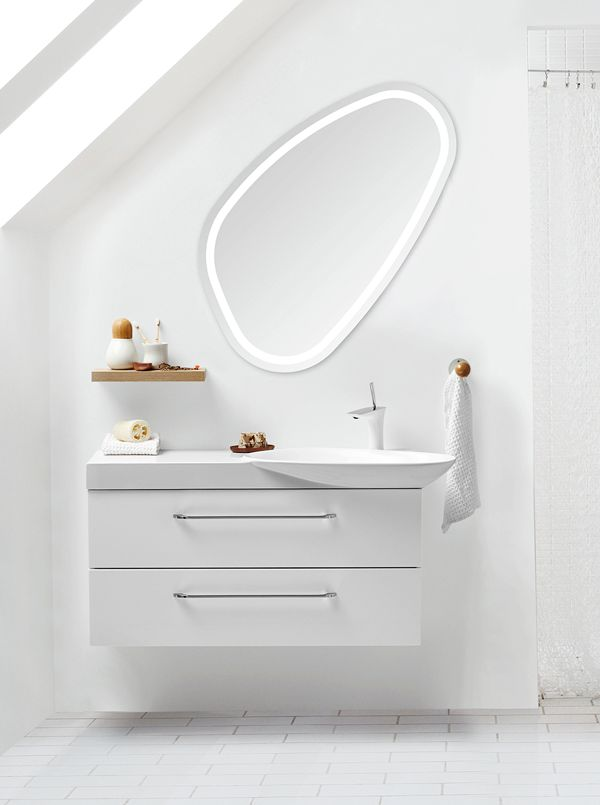 Solo mirror with integrated LED light panel. The organic shape mirror can be placed in any position you want.