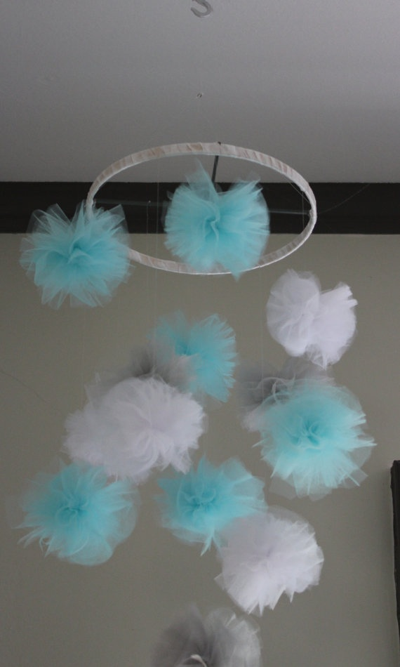 Pom Pom Crib Mobile - turquoise, gray, white. $40.00, via Etsy.