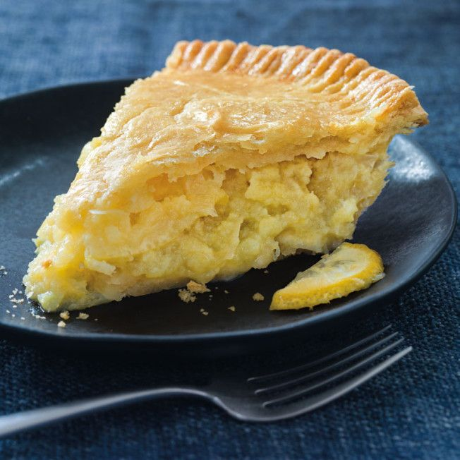 This sweet-tart Shaker lemon pie contains a chunky lemon curd filling, with big hits of tart lemon slices and slightly bitter peels.