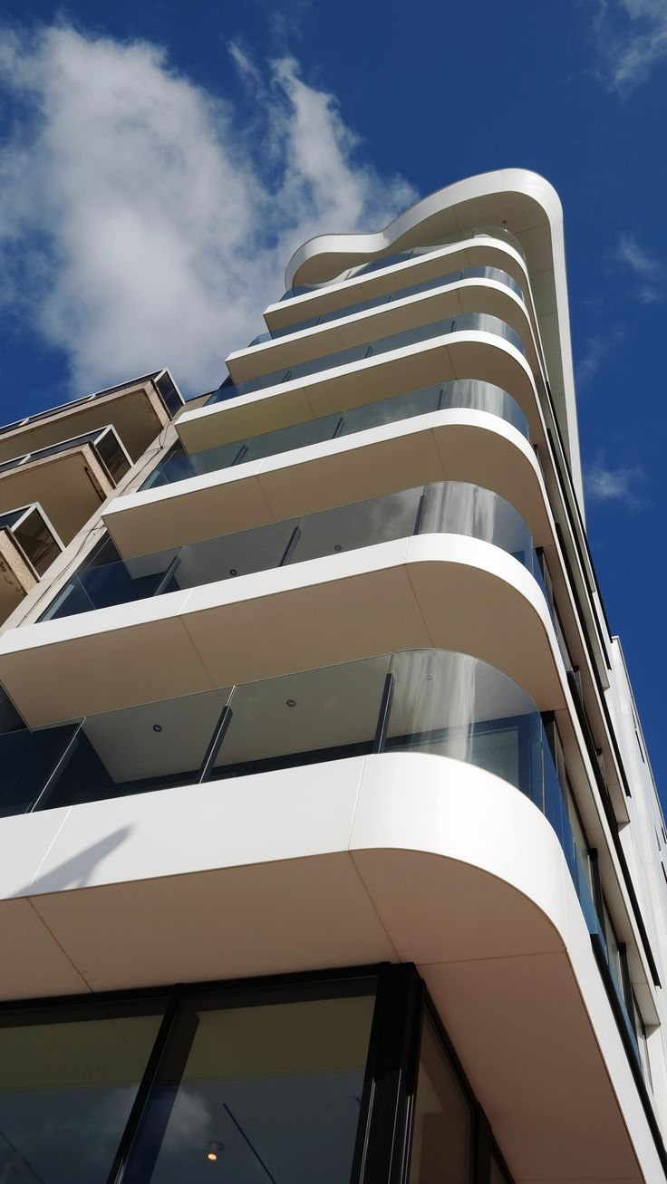 Exterior: Belgium Sunny Corner White Building Featuring Corian