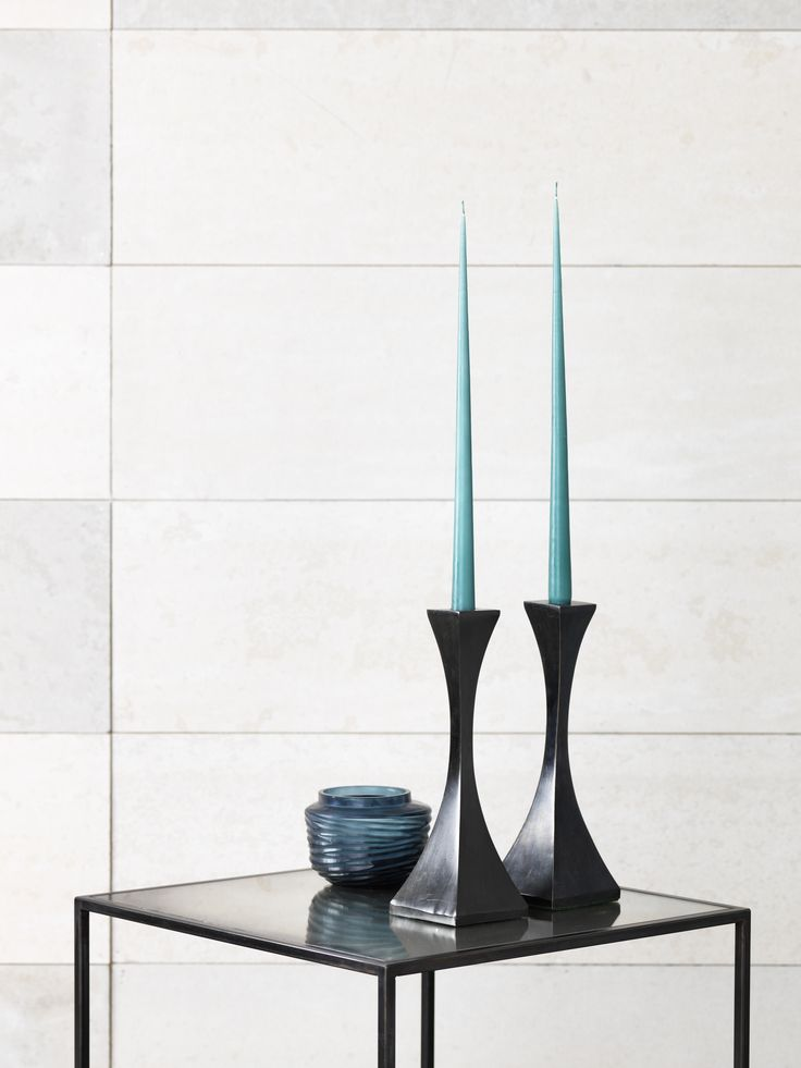 Capricorn candlesticks in solid bronze with patinated finish.