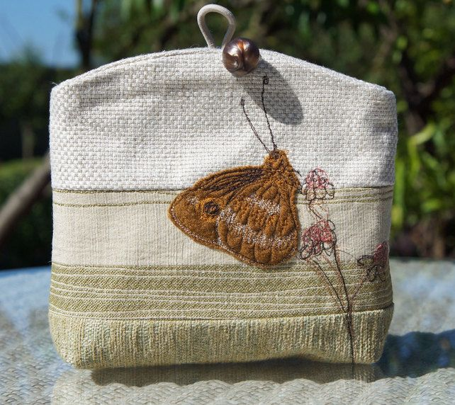 Cream clutch bag with applique butterfly £20.00