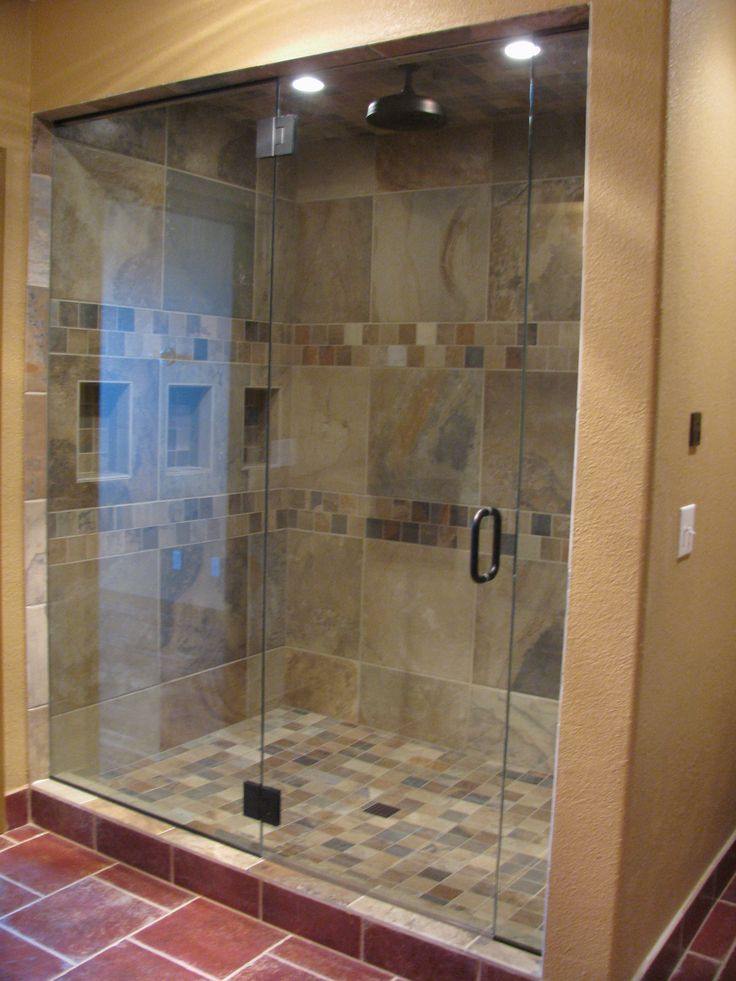 Replaced oversized tub with custom, walk-in steam shower with overhead sunflower head and wall jets. Slate material, built in niche, red floor tile, full height Euro glass, can lights.