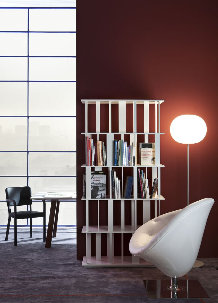 Forest bookcase by Driade. The Forest lacquered bookshelf of Driade was designed by Nendo in 2010. Made with solid wooden elements, is a perfect example of unique, simple but elegant design.