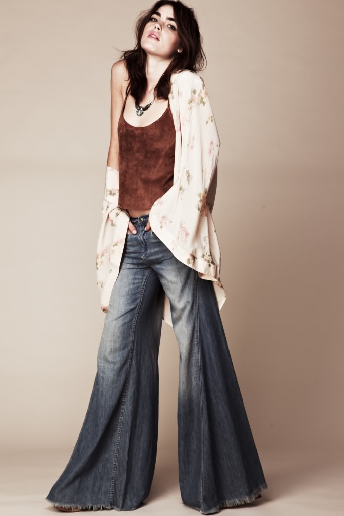 '70s-Bellbottoms!  Hers are too short.  You weren't cool unless you were walking all over your hem and fraying them.