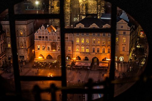 a peek of the town square from one of the small windows of the Prague orloj