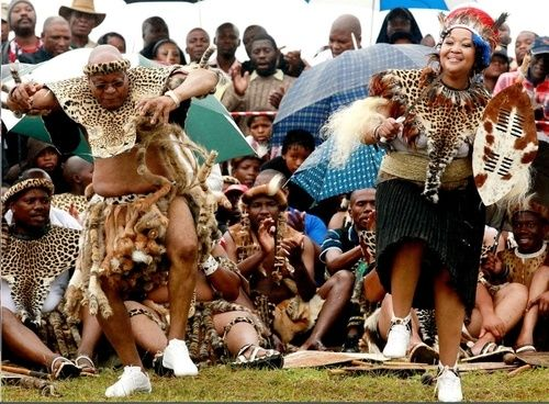 Jacob Zuma: President of Dancing Awesomely! The South African president pictured dancing at the traditional wedding ceremony to his 3rd wife - also pictured.