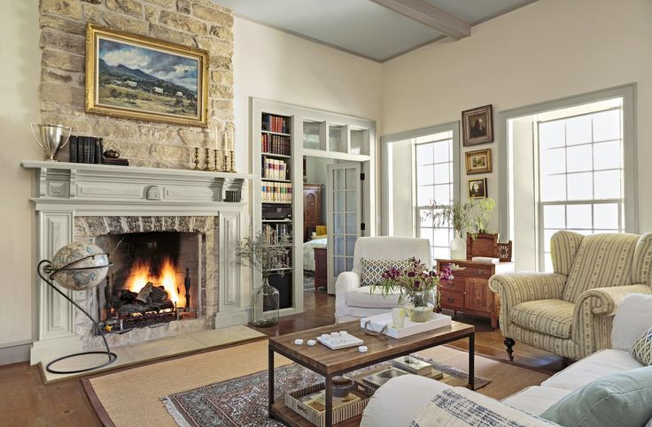 This bright, spacious living room and its fireplace were restored to their original historic charm, despite being previously marred by a dropped ceiling and wood-burning stove.